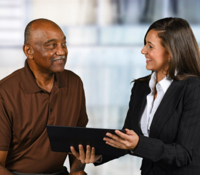 confident businesswoman who is working with an elderly client